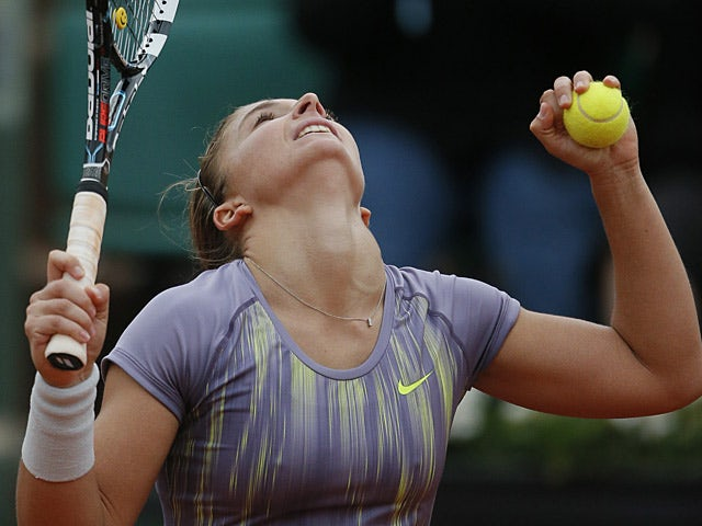 Sara Errani celebrates after defeating Carla Suarez Navarro during their fourth round match of the French Open on June 2, 2013