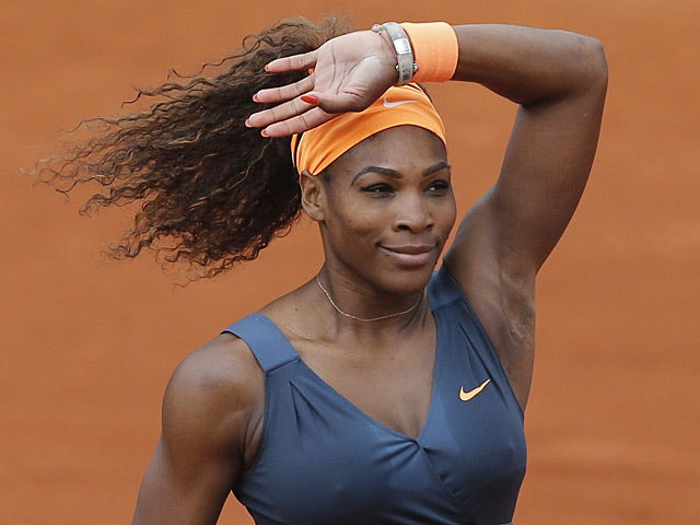 Serena Williams waves to fans after defeating Sorana Cirstea during their third round match of the French Open on May 31, 2013