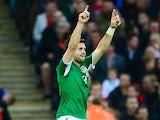 Ireland's Shane Long celebrates after scoring the opening goal against England on May 29, 2013