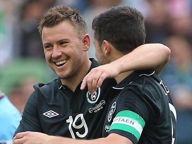 Ireland's Simon Cox celebrates with team mate Shane Long after scoring his team's second against Georgia in a friendly match on June 2, 2013