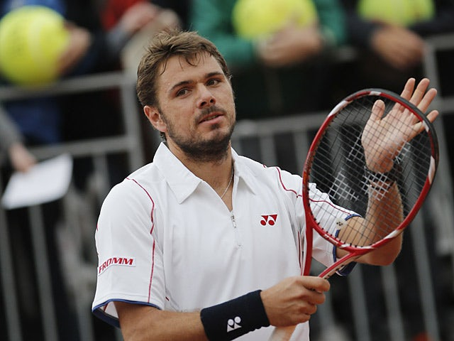 Stanislas Wawrinka celebrates after defeating Horacio Zeballos during their second round match of the French Open on May 31, 2013
