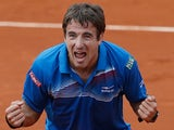 Tommy Robredo celebrates after defeating Gael Monfils during their third round match of the French Open on May 31, 2013
