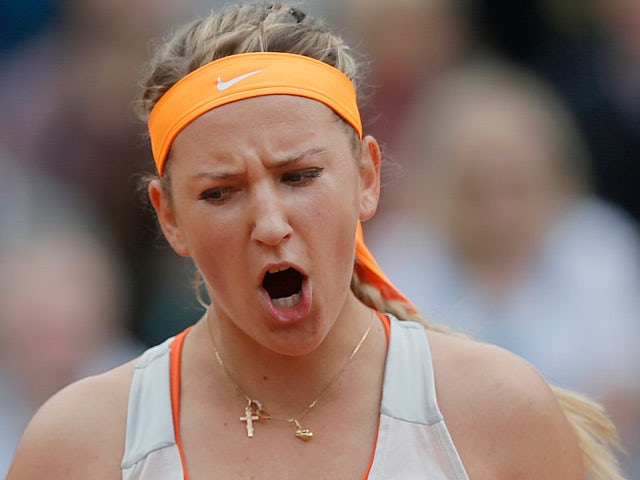 Victoria Azarenka celebrates after defeating Alize Cornet during their third round match of the French Open on June 1, 2013