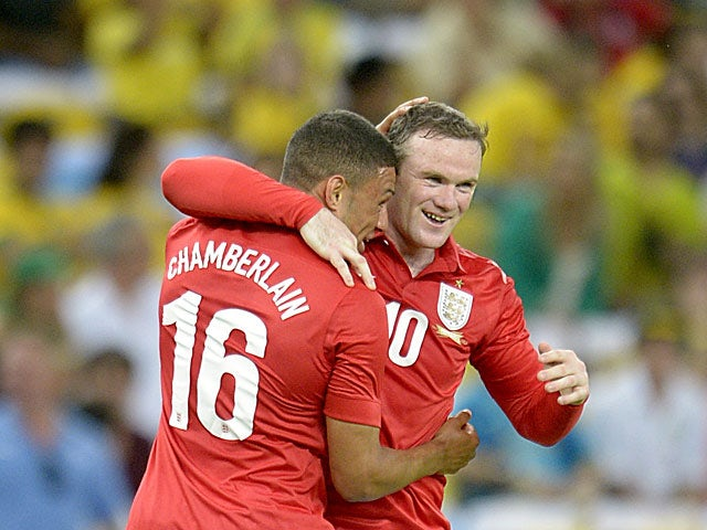 England's Wayne Rooney is congratulated by team mate Alex Oxlade-Chamberlain after scoring his team's second goal against Brazil during a friendly match on June 2, 2013
