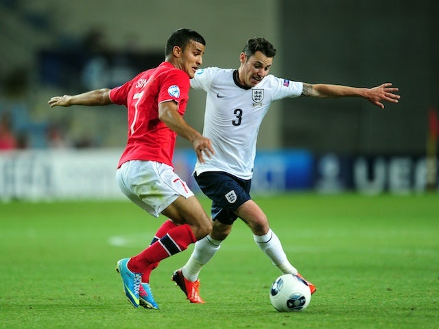 England's Adam Smith in action against Norway on June 8, 2013