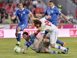 Italy's keeper Gianluigi Buffon saves a ball from Czech's Petr Jiracek during the World Cup qualifying match on June 7, 2013