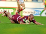 Huddersfield's Dale Ferguson scores a try against St Helens on June 3, 2013