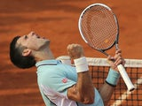 Serbia's Novak Djokovic celebrates defeating Germany's Tommy Haas in three sets during their Quarter Final match at the French Open tennis tournament on June 5, 2013