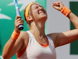 Victoria Azarenka celebrates he win over Russia's Maria Kirilenko during their quarterfinal match of the French Open tennis tournament on June 5, 2013