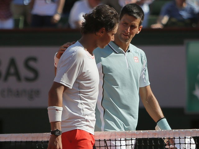 Spain's Rafael Nadal and Serbia's Novak Djokovic hug after their semifinal match of the French Open tennis tournament on June 7, 2013