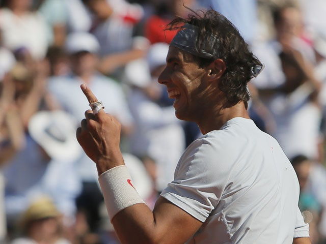 Spain's Rafael Nadal gestures as he defeats Serbia's Novak Djokovic during their semifinal match of the French Open tennis tournament on June 7, 2013