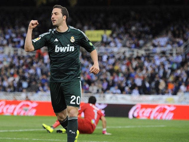 Real Madrid's Gonzalo Higuain celebrates after scoring against Real Sociedad on May 26, 2013