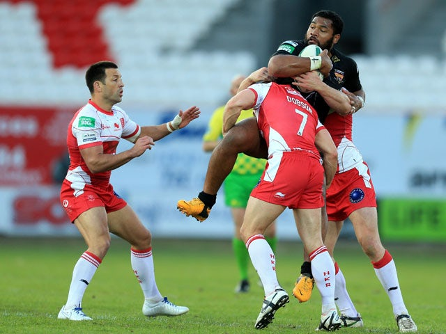 Hull KR's Michael Dobson and Rhys Lovegrove tackle Huddersfield Giants' Ukuma Ta'ia during the Super League match on June 7, 2013