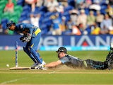 New Zealand's Mitchell McClenaghan dives in to make his ground and score the winning run during the match against Sri Lanka on June 9, 2013