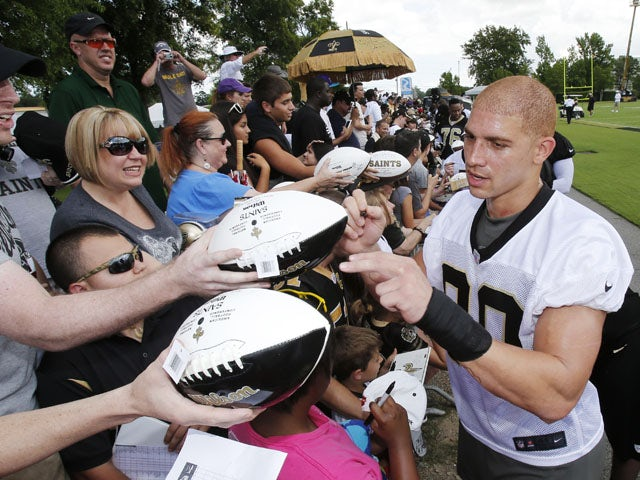 New Orleans Saints tight end Jimmy Graham signs autographs after an NFL practice session on June 4, 2013