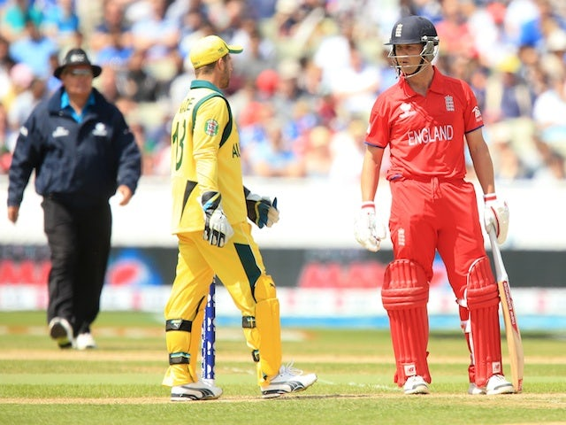 England's Jonathan Trott and Australia's Matthew Wade during the ICC Champions Trophy match on June 8, 2013