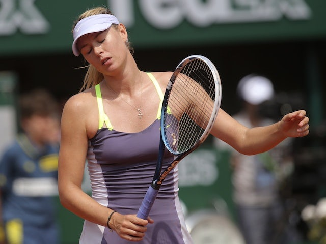 Maria Sharapova reacts to a shot played by Serena Williams during the French Open final on June 8, 2013