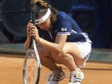 Martina Hingis looks dejected after failing to land a shot in.