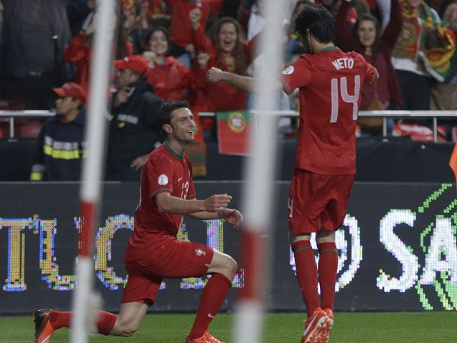 Portugal's Helder Postiga celebrates after scoring against Russia during the World Cup qualifying match on June 7, 2013