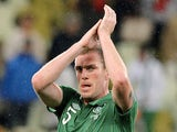 Rep of Ireland defender Richard Dunne applauds after a game with Georgia on June 2, 2013