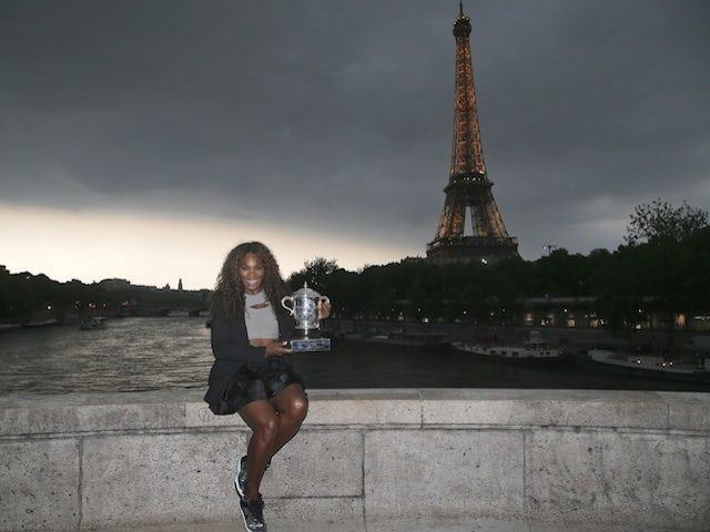 French Open champion Serena Williams poses with the trophy on June 8, 2013