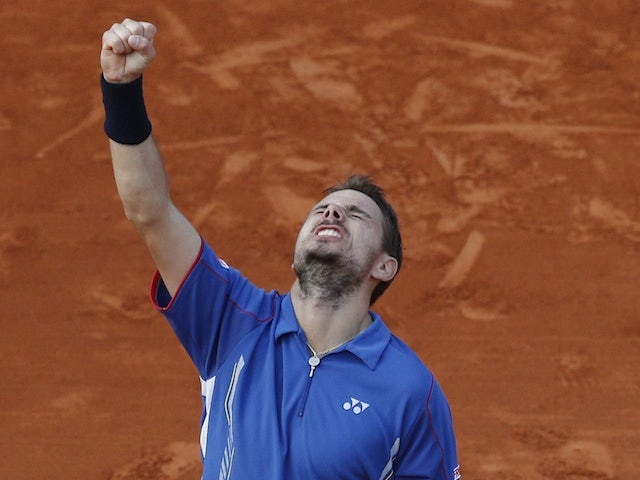 Stanislas Wawrinka celebrates a win over Richard Gasquet at the French Open on June 3, 2013