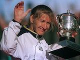 Steffi Graf celebrates with the French Open trophy.