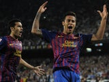 Thiago celebrates his goal for Barcelona with Pedro.