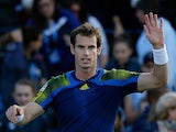 Andy Murray celebrates after beating opponent Benjamin Becker during their quarter final match at Queens on June 14, 2013