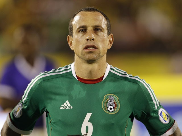 Mexico's Gerardo Torrado listens the national anthem before the start of the 2014 World Cup qualifying soccer match against Jamaica on June 4, 2013