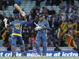 Sri Lanka's Kumar Sangakkara teammate Nuwan Kulasekera celebrate after they defeated England in their ICC Champions Trophy match on June 13, 2013