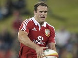 British and Irish Lions' Jamie Roberts runs with the ball during their rugby tour match against NSW and QLD combined country on June 11, 2013