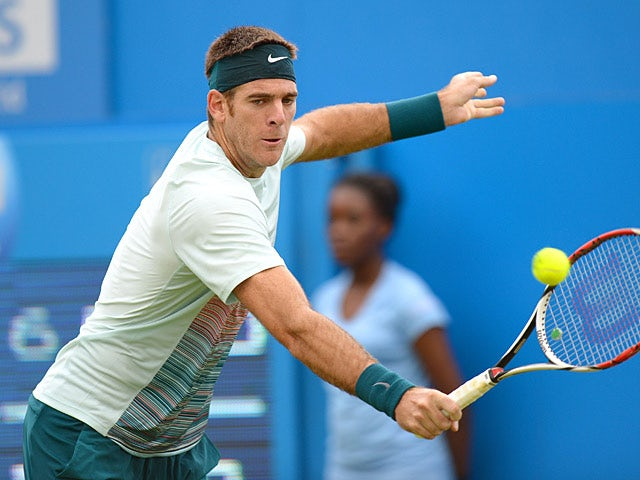 Juan Martin Del Potro in action against Xavier Malisse during the AEGON Championships at The Queen's Club on June 11, 2013