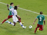 Italy's Mario Balotelli kicks the ball to score his team's second goal during the soccer Confederations Cup group A match between Mexico and Italy on June 16, 2013