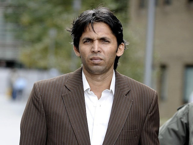 Pakistan's Mohammad Asif leaves court on June 12, 2013