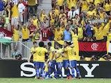 Brazil players congratulate Neymar following a goal against Japan on June 15, 2013