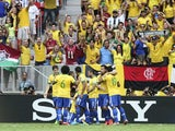 Brazil players congratulate Neymar following a goal against Japan on June 15, 2013
