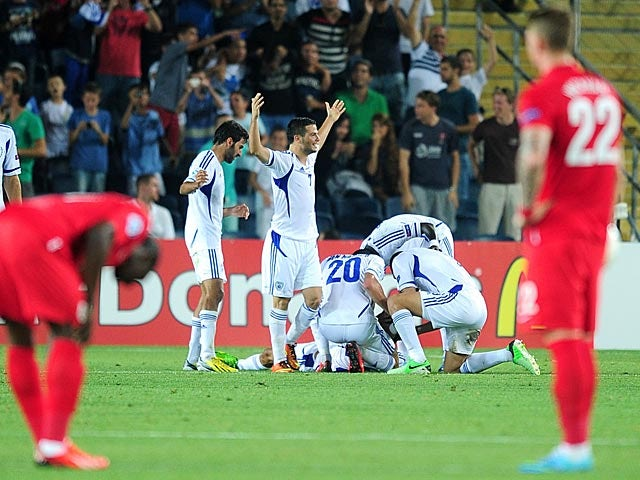 Israel's Ofir Kriaf is mobbed by team mates after scoring the opener against England during the European U21 Championships on June 11, 2013