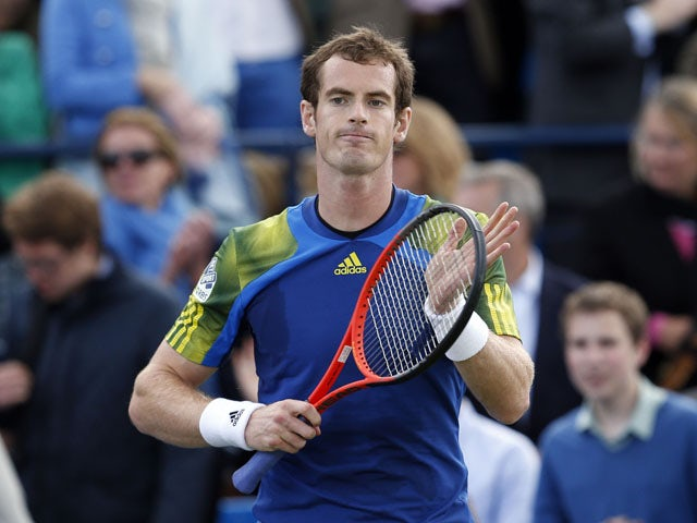 Andy Murray celebrates his victory against Marinko Matosevic at the AEGON Championships at The Queen's Club on June 13, 2013