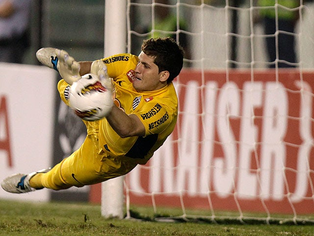 Santos' goalkeeper Rafael saves a penalty on May 24, 2012