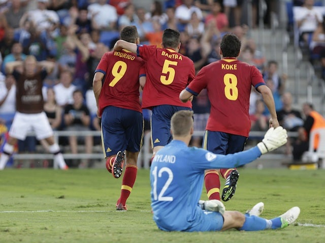 Spain's players celebrate a goal against Russia on June 15, 2013