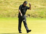 Phil Mickelson reacts after his birdie putt on the ninth hole during the first round of the U.S. Open golf tournament on June 13, 2013