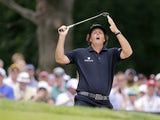 Phil Mickelson reacts to his shot from the bunker on the second hole during the fourth round of the U.S. Open golf tournament on June 16, 2013