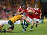 British and Irish Lions' Jamie Heaslip holds off a tackle from Australia's Kane Douglas on June 22, 2013