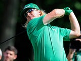 Charley Hoffman hits a drive on the 18th during the first round of the Travelers Championship on June 20, 2013