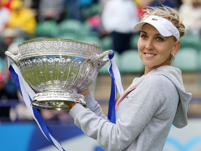 Russia's Elena Vesnina lifts the tournament trophy after winning the final match against USA's Jamie Hampton during the AEGON International on June 22, 2013