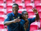 France's Geoffrey Kondogbia is congratulated by team mate Yaya Sanogo against Ghana during the Under-20 World Cup on June 21, 2013