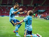 Spain's Gerard Deulofeu is congratulated by team mate Jese after scoring his team's second goal against USA during the Under-20 World Cup on June 21, 2013