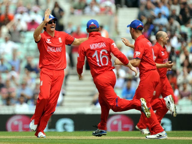 England captain Alastair Cook celebrates after a run out during the ICC Champions Trophy match against South Africa on June 19, 2013