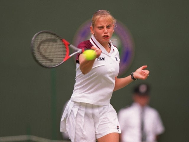 Jelena Dokic plays a shot against Martina Hingis at Wimbledon.